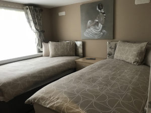 twin bedroom chalet red deer holiday park